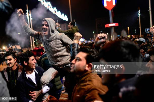 Revellers bid farewell to 2017 as they gather to celebrate New Years in Istanbul on December 31 2017 Turkey arrested on December 31 more suspected...
