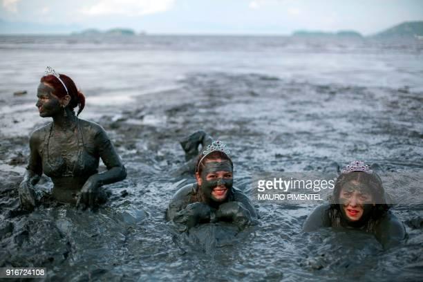 TOPSHOT Revellers celebrate during the Bloco da Lama a mud carnival in Paraty Brazil on February 10 2018 Bloco da Lama started in 1986 by teenagers...
