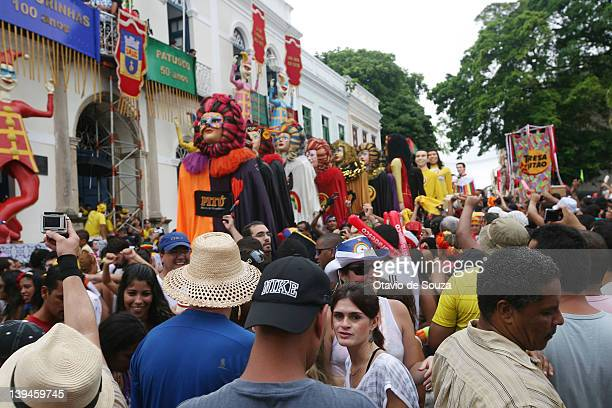 Revellers celebrate during the Gian Puppets parade in Olinda City on February 18 2011 in Recife state Brazil Carnival is the biggest and most popular...