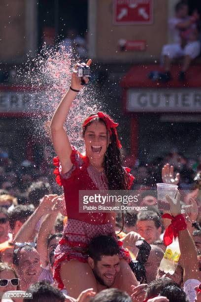 Revellers celebrate during the opening day or 'Chupinazo' of the San Fermin Running of the Bulls fiesta on July 6 2013 in Pamplona Spain The annual...