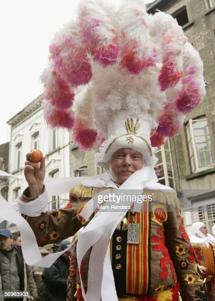 Revellers celebrate the Binche Mardi Gras, which has been recently granted World Heritage status by UNESCO, on February 28, 2006 in Binche, Belgium.