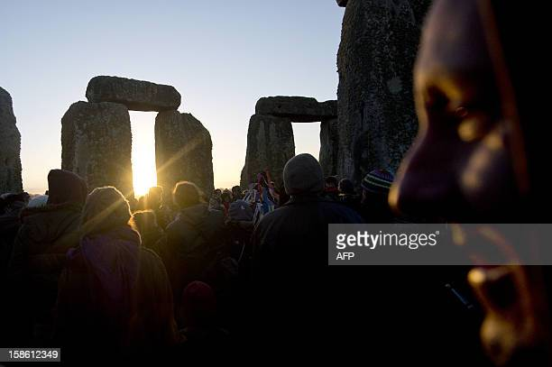 Revellers celebrate the pagan festival of 'Winter Solstice' at Stonehenge in Wiltshire in southern England on December 21 2012 AFP PHOTO/BEN STANSALL