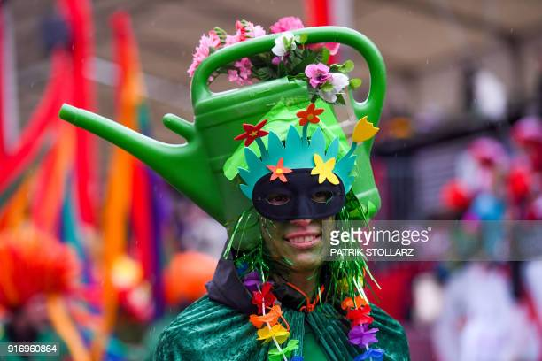 Revellers celebrate the street carnival at the school and quarterparade Schuul en Veedelzuch on February 11 2018 in Cologne western Germany / AFP...