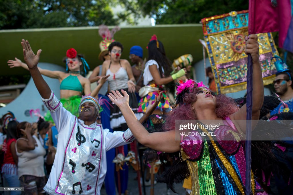 Revellers celebrate the street carnival parade of the 'Loucura Suburbana' bloco at the Engenho de Dentro neighborhood in Rio de Janeiro, Brazil, on February 8, 2018. The 'Loucura Suburbana' street carnival group is organized by workers and patients at the Nise da Silveira psychiatric hospital. The parade starts inside the hospital and winds its way through the streets of the neighborhood. /