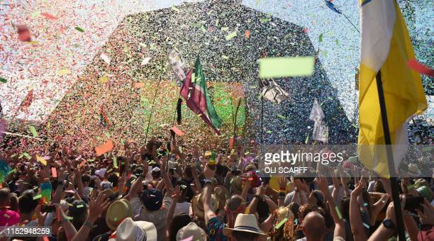 TOPSHOT Revellers cheer as Australian singer Kylie performs at the Glastonbury Festival of Music and Performing Arts on Worthy Farm near the village...