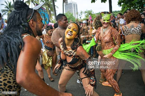 Revellers cheer during the Amigos da Onca street party in Rio de Janeiro Brazil on February 22 2020 ahead of Rio's annual world famous carnival Rio's...