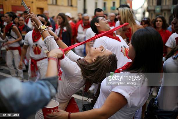 Revellers continue to party and dance through the night and day during the second day of the San Fermin Running Of The Bulls festival on July 7 2014...