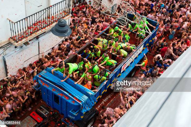 Revellers covered in tomato pulp take part in the annual 'Tomatina' festival in the eastern town of Bunol on August 30 2017 The iconic fiesta which...