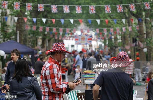 Revellers crack open another bottle of bubbly during a street party on Niton Street on June 2 2012 in Fulham southwest London England For only the...