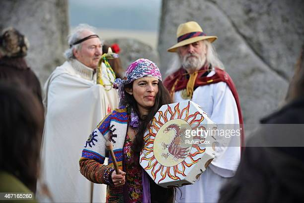 Revellers dance and play music during celebrations marking the spring equinox at Stonehenge on March 21 2015 in Wiltshire England An estimated 700...