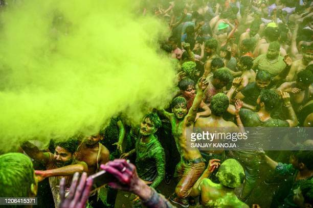 Revellers dance as they celebrate Holi the spring festival of colours in Allahabad on March 10 2020