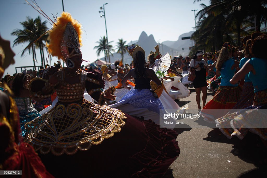 Revellers dance during Carnival celebrations at the Rio Maracatu 'bloco', or street parade, on February 9, 2016 in Rio de Janeiro, Brazil. Festivities have continued throughout major Brazilian cities for Carnival in spite of the threat of the Zika virus. Today is the last official day of Carnival.
