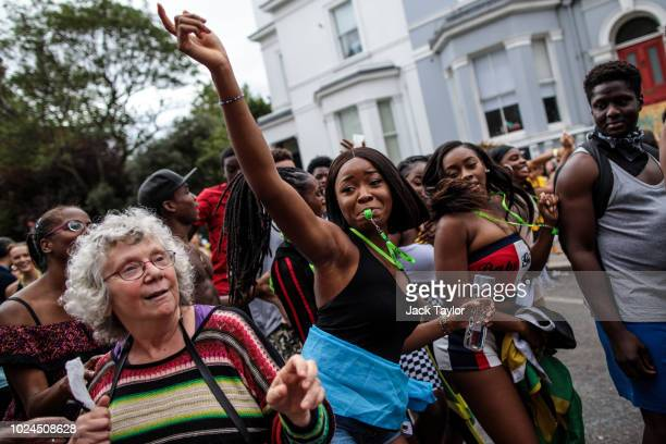 Revellers dance on the final day of the Notting Hill Carnival on August 27, 2018 in London, England. The Notting Hill Carnival, which has taken place...