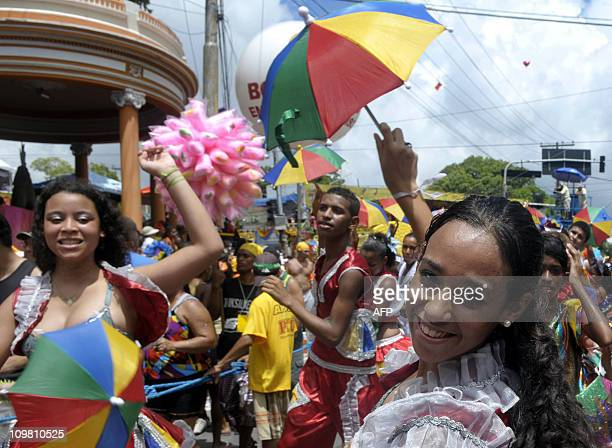 Revellers dance the traditional frevo an accelerated polkalike dance during Recife's Carnival in the northeastern state of Pernambuco on March 6 2011...