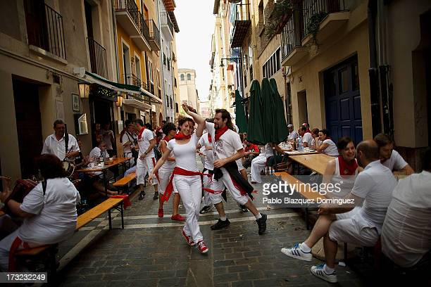 Revellers dance while musicians from Oberena play traditional Basque Country music in the street after having lunch on the fifth day of the San...