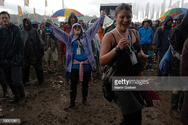 Revellers dancing in the rain and mud in front of the Jazz Stage at Glastonbury 22nd June 2007