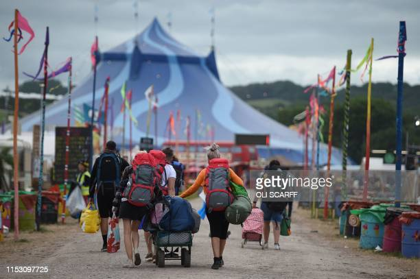 Revellers depart Glastonbury Festival of Music and Performing Arts on Worthy Farm near the village of Pilton in Somerset, South West England, on July...