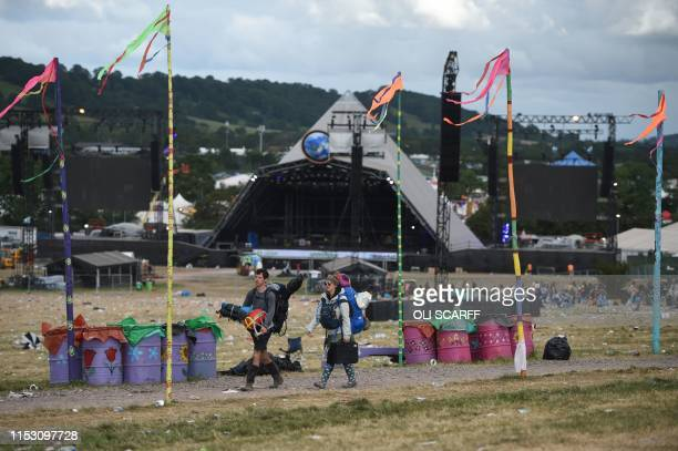 Revellers depart Glastonbury Festival of Music and Performing Arts on Worthy Farm near the village of Pilton in Somerset South West England on July 1...