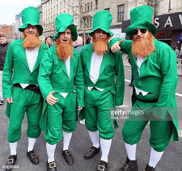Revellers dressed as leprechauns pose for a photograph on O'Connell Street as the largest St Patrick's day celebrations in Ireland makes its way...
