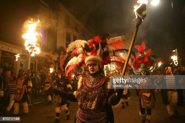 Revellers dressed as Zulu warriors parade through the streets of Lewes in Sussex southern England on November 4 during the traditional Bonfire Night...