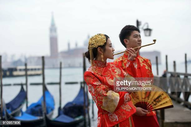 Revellers dressed in Asian costumes take part in the Venice Carnival on January 27 2018 / AFP PHOTO / FILIPPO MONTEFORTE
