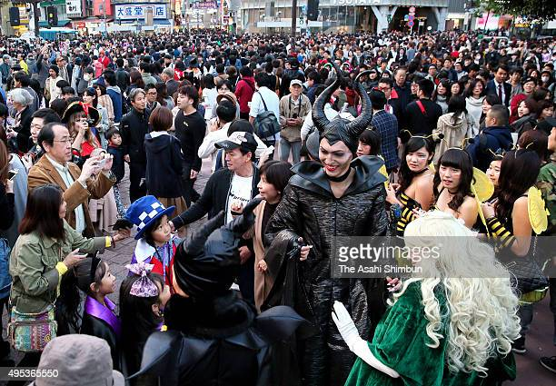 Revellers dressed in Halloween costumes gather at Shibuya crossing at Halloween night on October 31 2015 in Tokyo Japan