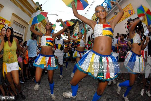 Revellers dressed in traditional frevo costumes take over the streets of Olinda to play and watch the traditional giant dolls parade as part of the...