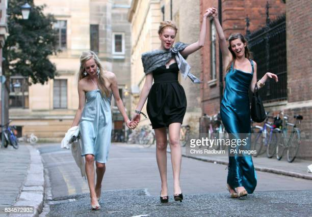 Revellers Emily Knight Lucy Ward and Jessica Swinton make their way home after celebrating the end of the university term by going to a May Ball at...