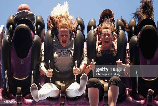 Revellers enjoy a hair rasing ride on a fair ground at the annual Goose Fair on October 6 2010 in Nottingham England The Goose Fair is one of...