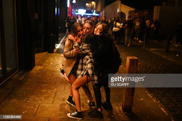 Revellers enjoy a night out in central Liverpool, northwest England, on December 30, 2020 before hightened Tier 3 restrictions closing hospitality...