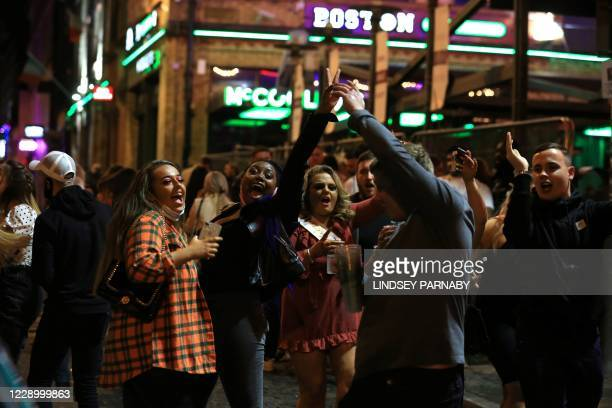 Revellers enjoy a night out in the centre of Liverpool, north west England on October 10, 2020 ahead of new measures set to be introduced in the...