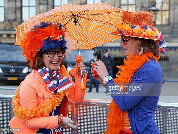 Revellers enjoy a party atmosphere in Dam Square one day prior to the coronation of Crown Prince Willem Alexander of The Netherlands on April 29,...