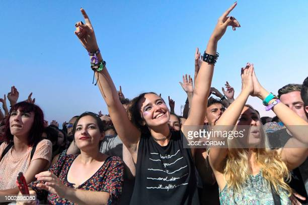 Revellers enjoy a performance on the second day of the Benicassim International Music Festival in Benicassim on July 20, 2018.