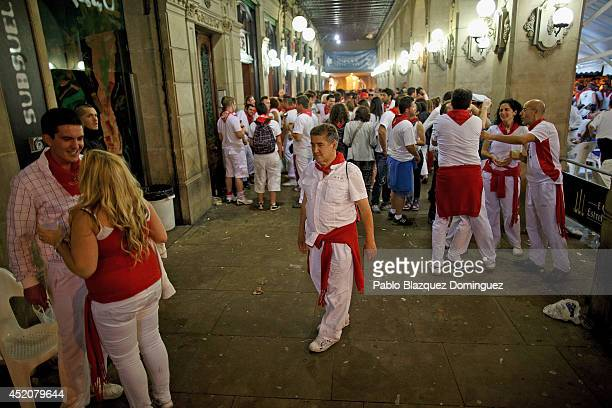 Revellers enjoy at Plaza del Castillo during the seventh day of the San Fermin Running Of The Bulls festival on July 12 2014 in Pamplona Spain The...