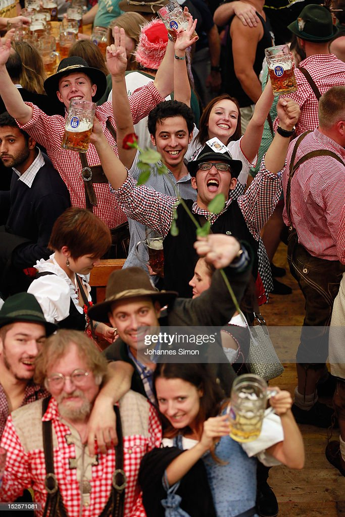 Revellers enjoy drinking beer during day 1 of Oktoberfest beer festival at Hofbraeuhaus beer tent on September 22, 2012 in Munich, Germany.This year's edition of the world's biggest beer festival Oktoberfest will run until October 7, 2012.
