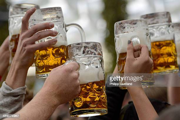 Revellers enjoy free beer at the Hofbraeu tent on the opening day of the 2015 Oktoberfest on September 19 2015 in Munich Germany The 182nd...