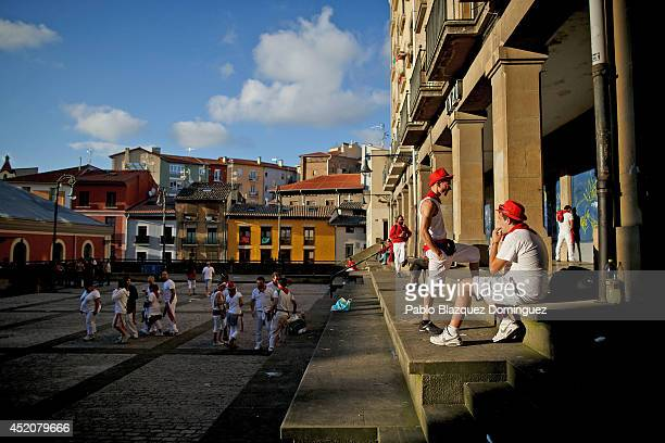 Revellers enjoy sunshine outdoors during the seventh day of the San Fermin Running Of The Bulls festival on July 12 2014 in Pamplona Spain The annual...