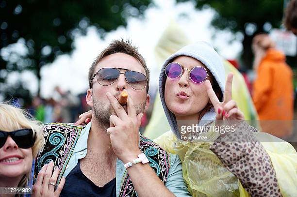 Revellers enjoy the atmopshere during the second day of Glastonbury Festival 2011 at Worthy Farm on June 24 2011 in Glastonbury United Kingdom