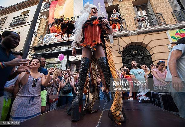 Revellers enjoy the atmosphere during the 2016 Madrid Gay Pride week on June 30 2016 in Madrid Spain Hundreds of thousands of revellers celebrate the...