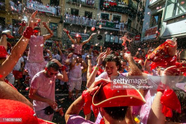 Revellers enjoy the atmosphere during the opening day or 'Chupinazo' of the San Fermin Running of the Bulls fiesta on July 06 2019 in Pamplona Spain...