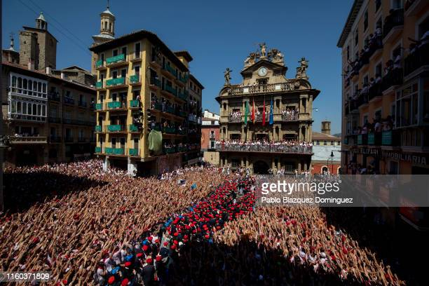 Revellers enjoy the atmosphere during the opening day or 'Chupinazo' of the San Fermin Running of the Bulls fiesta on July 06, 2019 in Pamplona,...