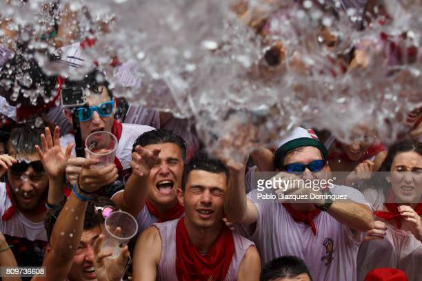 Revellers enjoy the atmosphere during the opening day or 'Chupinazo' of the San Fermin Running of the Bulls fiesta on July 6 2017 in Pamplona Spain...
