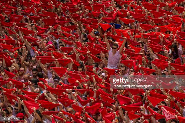 Revellers enjoy the atmosphere during the opening day or 'Chupinazo' of the San Fermin Running of the Bulls fiesta on July 6 2018 in Pamplona Spain...