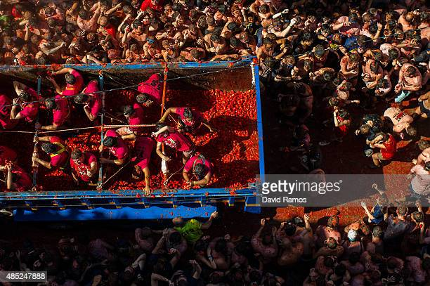 Revellers enjoy the atmosphere in tomato pulp while participating the annual Tomatina festival on August 26 2015 in Bunol Spain An estimated 22000...