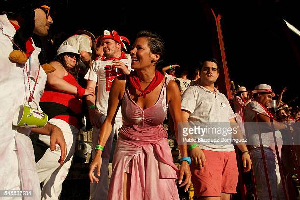 Revellers enjoy the atmosphere inside Pamplona's bullring during a bullfight on the third day of the San Fermin Running of the Bulls festival on July...