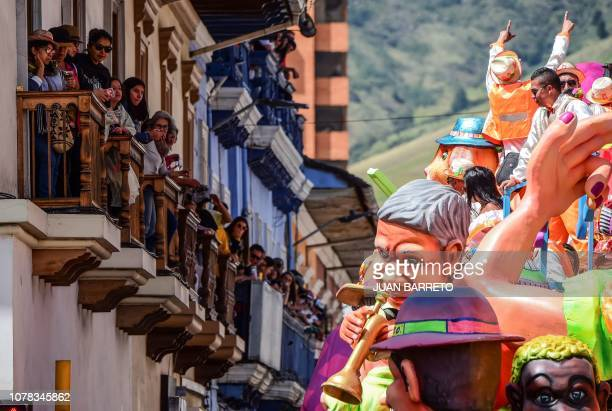 Revellers enjoy the 'White Day' parade in Pasto Colombia on January 6 during the Carnival of Blacks and Whites the largest festivity in the...