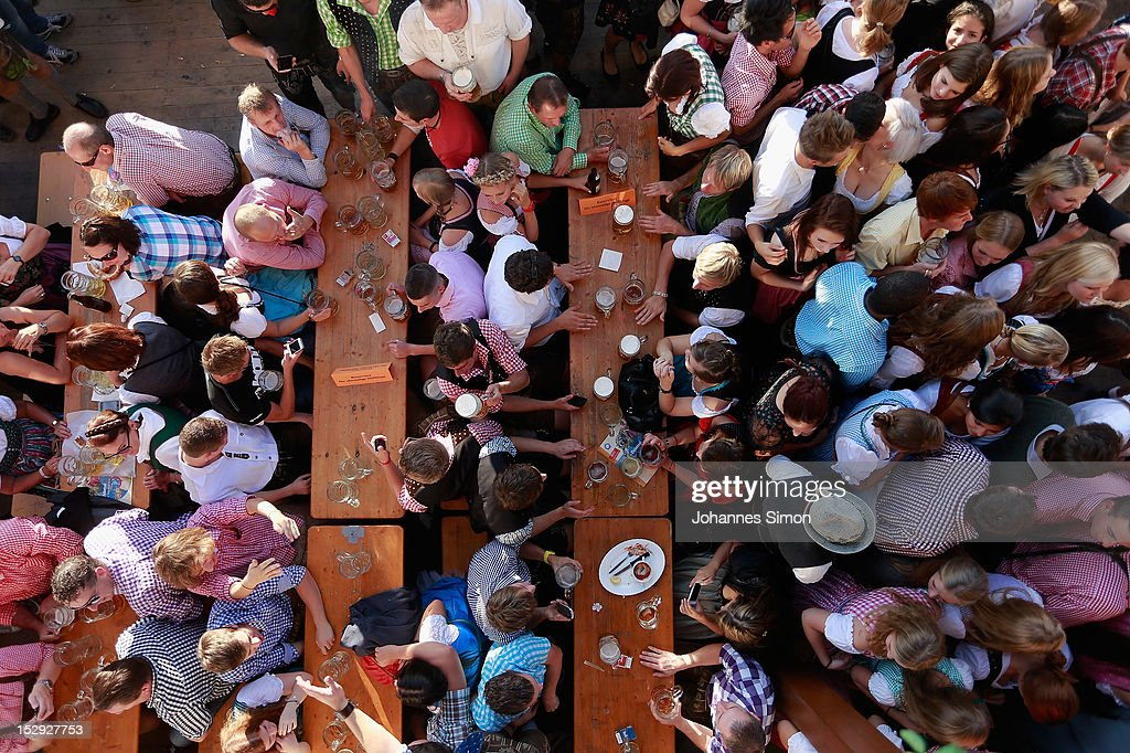 Revellers enjoy themselves as they drink beer outside the Braeurosl beer tent during day 7 of Oktoberfest beer festival on September 28, 2012 in Munich, Germany. This year's edition of the world's biggest beer festival Oktoberfest will run until October 7, 2012.
