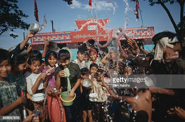 Revellers enjoying a water fight during the New Year Thingyan Water Festival in Bago Myanmar May 1971