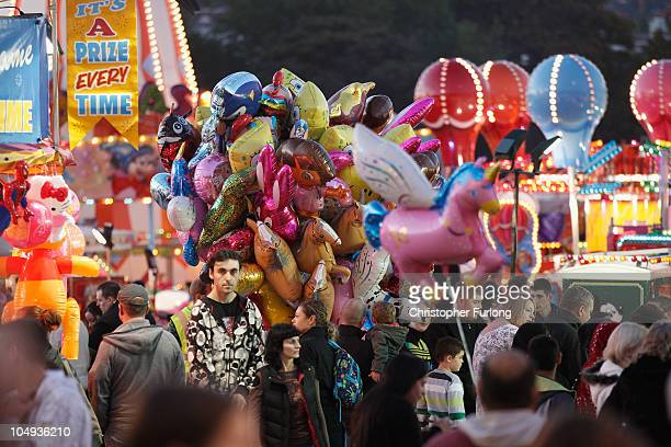 Revellers flock to the traditional fair ground at the annual Goose Fair on October 6 2010 in Nottingham England The Goose Fair is one of Europe's...
