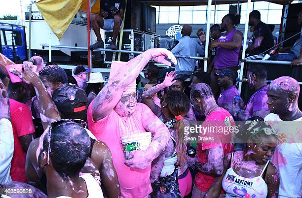 Revellers from the band Think Pink parade and party wearing pink paint during the early morning J'ouvert street procession as part of Trinidad and...